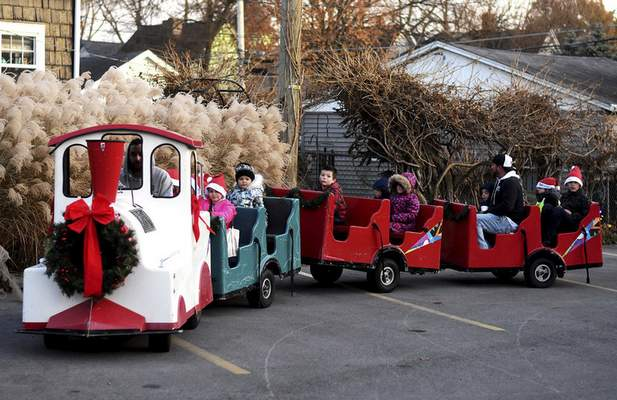 Groups of children take train rides Friday before the tree lighting during Christmas on Broadway.
