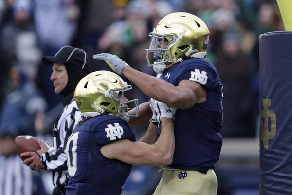 Notre Dame wide receiver Chase Claypool celebrates a touchdown against Boston College with wide receiver Chris Finke during the 40-7 Irish win at Notre Dame Stadium on Saturday. (AP Photo/Michael Conroy)