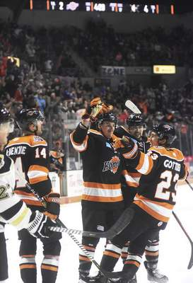 Katie Fyfe | The Journal Gazette Komets players celebrate after Brycen Martin scores during the second period Saturday against Wheeling at Memorial Coliseum.