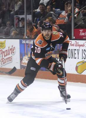 Katie Fyfe | The Journal Gazette  Komets' Shawn St-Amant carries the puck during the first period against the Wheeling Nailers at Memorial Coliseum on Saturday.
