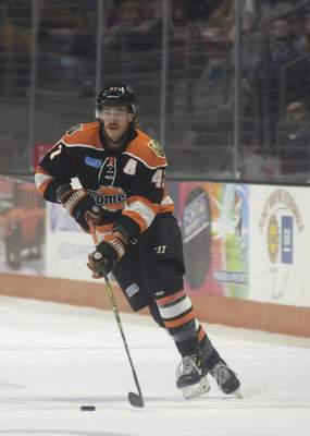 Katie Fyfe | The Journal Gazette  Komets' A.J. Jenks carries the puck during the first period against Wheeling Nailers at Memorial Coliseum on Saturday.
