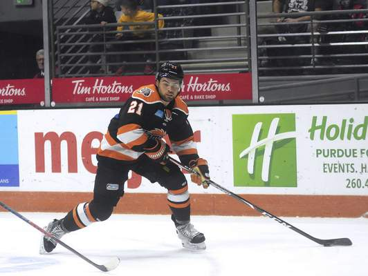 Katie Fyfe | The Journal Gazette  Komets' Markus Phillips carries the puck during second period against Wheeling Nailers at Memorial Coliseum on Saturday.