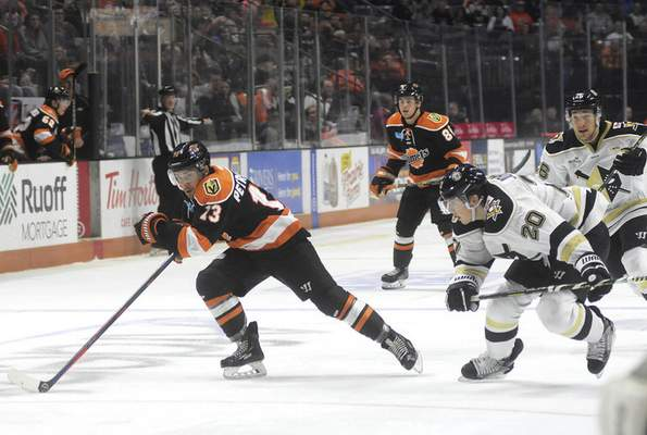 Katie Fyfe | The Journal Gazette Fort Wayne's Anthony Petruzzelli carries the puck during the second period Saturday against the Wheeling Nailers at Memorial Coliseum.