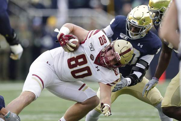 Associated Press photos Boston College tight end Hunter Long is tackled by cornerback Shaun Crawford during the first half of Notre Dame's 40-7 win Saturday in South Bend.