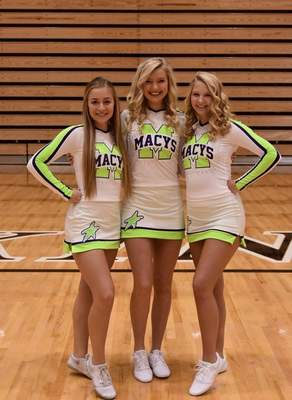 Courtesy Dylinn Hertel, Arianna Betterly, and Lauryne Pearson show off their new Macy's costumes before their trip to New York to march in the Thanksgiving Day parade. They are the only high school cheerleaders from Indiana in the parade.