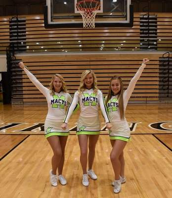 Courtesy photo  Dylinn Hertel, Arianna Betterly, and Lauryne Pearson in their new Macy's costumes run through a cheer before their trip to New York City to march in the Thanksgiving Day's Parade. They are the only high school cheerleaders from Indiana at the event.