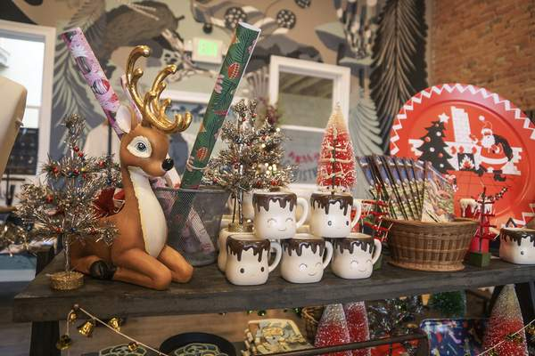 At Fancy & Staple on Broadway, owner Taber Olinger uses social media to entice shoppers as Christmas approaches.