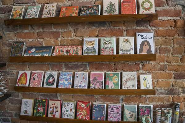 Mike Moore | The Journal Gazette Various holiday greeting cards on display for sale at Fancy & Staple at 1111 Broadway St. on Tuesday 11.19.19