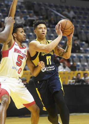 Katie Fyfe   The Journal Gazette Mad Ants' Stephan Hicks looks to pass to a teammate while the WIndy City Bulls' Justin Simon defends him during the third quarter at Memorial Coliseum on Sunday.
