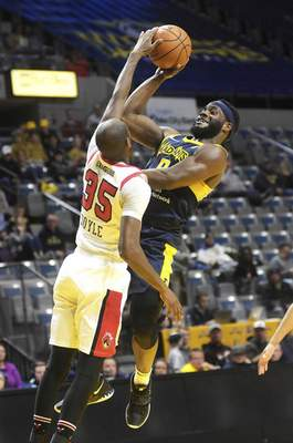 Katie Fyfe   The Journal Gazette Mad Ants' Ike Nwamu goes to shoot the ball but gets blocked by the Windy City Bulls' Milton Doyle during the fourth quarter at Memorial Coliseum on Sunday.