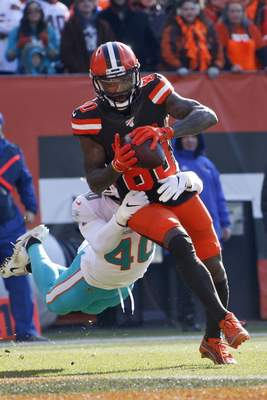 Cleveland Browns wide receiver Jarvis Landry scores a 7-yard touchdown during the first half of an NFL football game against the Miami Dolphins, Sunday, Nov. 24, 2019, in Cleveland. (AP Photo/Ron Schwane)