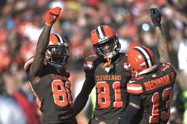 Cleveland Browns wide receiver Jarvis Landry (80) celebrates with Cleveland Browns wide receiver Odell Beckham Jr. (13) and wide receiver Rashard Higgins (81) after Landry scored a 7-yard touchdown during the first half of an NFL football game against the Miami Dolphins, Sunday, Nov. 24, 2019, in Cleveland. (AP Photo/David Richard)