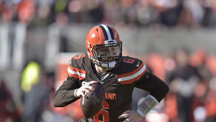Cleveland Browns quarterback Baker Mayfield scrambles during the first half of an NFL football game against the Miami Dolphins, Sunday, Nov. 24, 2019, in Cleveland. (AP Photo/David Richard)