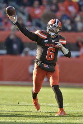 Cleveland Browns quarterback Baker Mayfield throws during the first half of an NFL football game against the Miami Dolphins, Sunday, Nov. 24, 2019, in Cleveland. (AP Photo/David Richard)