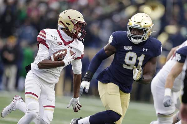 Associated Press Notre Dame defensive end Ade Ogundeji chases down Boston College's Zay Jones for one of Ogundeji's career-high three tackles for loss against the Eagles on Saturday. He  had two sacks.