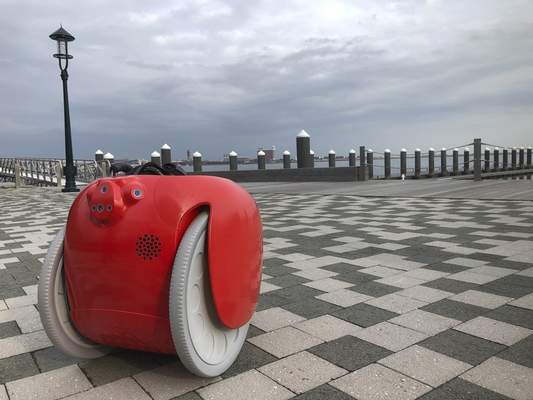 A cargo-carrying robot called the Gita sits near a waterfront park on Monday, Nov. 11, 2019, in Boston. (AP Photo /Matt O'Brien)