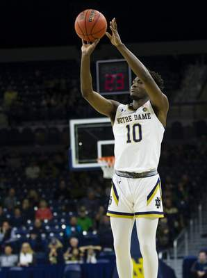 Notre Dame's Temple 'T.J.' Gibbs (10) shoots during an NCAA college basketball game Tuesday, Nov. 26, 2019, in South Bend, Ind. (Michael Caterina/South Bend Tribune via AP)