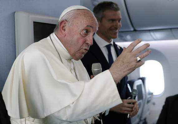 Pope Francis speaks during a news conference onboard the papal plane on his flight back from a trip to Thailand and Japan, Monday, Nov. 26, 2019. (Remo Casilli/Pool Photo via AP)