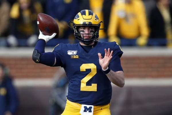 Associted Press photos Michigan quarterback Shea Patterson is ready for a rematch with the Buckeyes after transferring from Ole Miss.