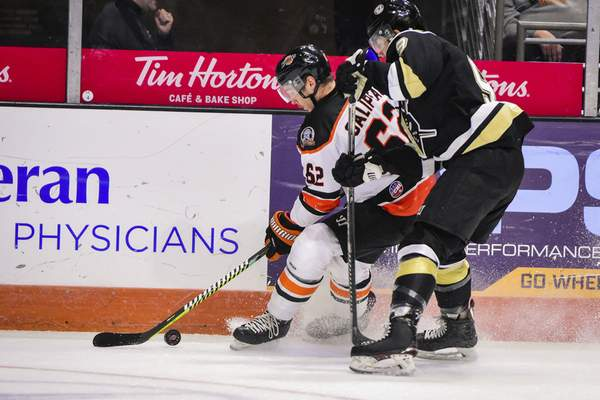 Mike Moore | The Journal Gazette Komets defenseman Olivier Galipeau nabs the puck in the first period against Wheeling at Memorial Coliseum on Thursday.