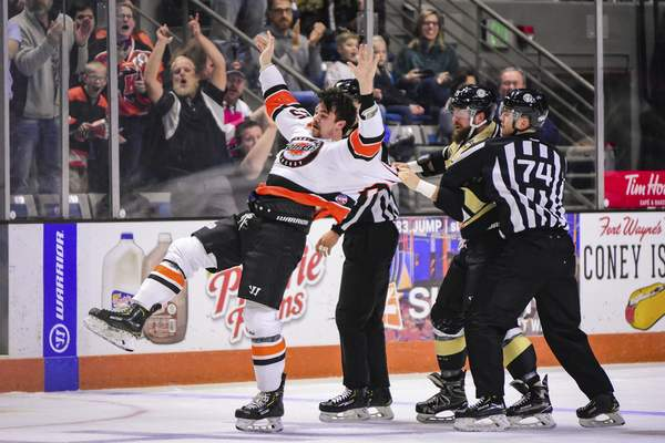 Mike Moore   The Journal Gazette Komets defenseman Kyle Haas is dragged to the ice by Nailers forward Brad Drobot while being escorted off the ice by officials for fighting in the first period at Memorial Coliseum on Thursday.