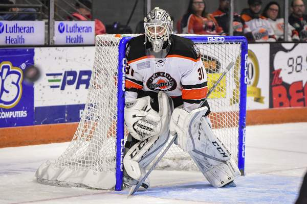 Mike Moore | The Journal Gazette Komets goaltender Cole Kehler watches the puck while defending the net in the first period against Wheeling at Memorial Coliseum on Thursday.