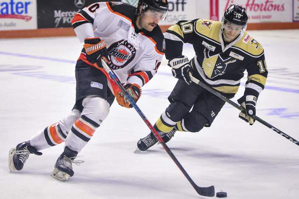 Mike Moore | The Journal Gazette Komets forward Brady Shaw controls the puck in the first period against Wheeling at Memorial Coliseum on Thursday.