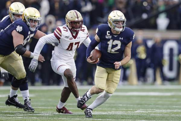 Associated Press Stanford coach David Shaw is focused on stopping Notre Dame quarterback Ian Book during Saturday's matchup.