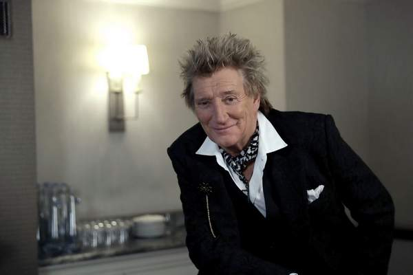 In this photo taken on Thursday, Nov. 14, 2019, British singer Rod Stewart poses for the media after an interview with The Associated Press at a hotel in London. (AP Photo/Matt Dunham)