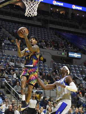 Rachel Von Stroup | The Journal Gazette  The Mad Ants' Walt Lemon, Jr. goes in for a layup against theLegends' Aric Holman during the second quarter at Memorial Coliseum on Friday night.