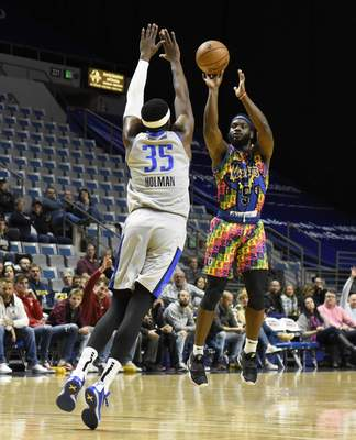 Rachel Von Stroup | The Journal Gazette  The Mad Ants' Ike Nwamu shoots the ball over the Legends' Aric Holman during the first quarter at Memorial Coliseum on Friday night.