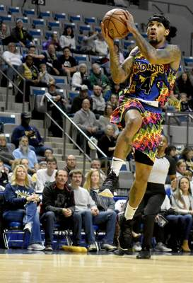 Rachel Von Stroup | The Journal Gazette  The Mad Ants' Walt Lemon, Jr.goes up for a shot during the second quarter against the Texas Legends at Memorial Coliseum on Friday night.