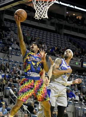 Rachel Von Stroup | The Journal Gazette  The Mad Ants' Walt Lemon, Jr.goes in for a layup against the Legends' Brandon Fields during the first quarter at Memorial Coliseum on Friday night.