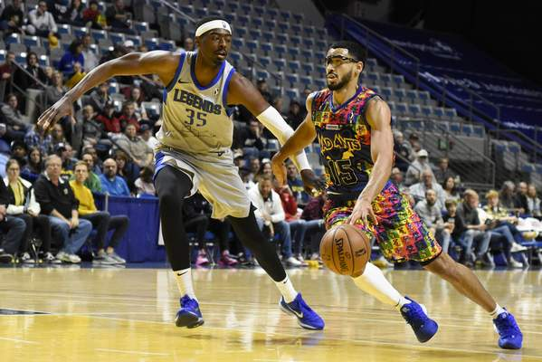 Rachel Von Stroup | The Journal Gazette  The Mad Ants' Naz Mitrou-Long drives past the Legends' Aric Holman during the first quarter at Memorial Coliseum on Friday night.