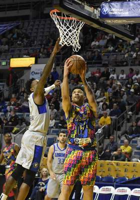 Rachel Von Stroup | The Journal Gazette  The Mad Ants' Stephan Hicksgoes up for a shot during the second quarter against the Legends at Memorial Coliseum on Friday night.