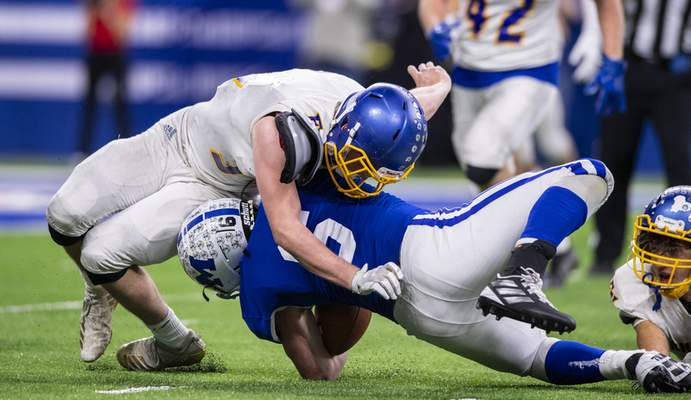 during the second half of action in the 47th annual IHSAA class 4A football state finals at Lucas Oil Stadium, Saturday, Nov. 30, 2019. Evansville Memorial High School won 21-3. (Doug McSchooler/for Journal-Gazette)