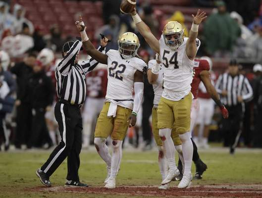 Associated Press Notre Dame's John Shannon, right, and Asmar Bilal celebrate a pivotal blocked punt during Saturday's win in Stanford, Calif.