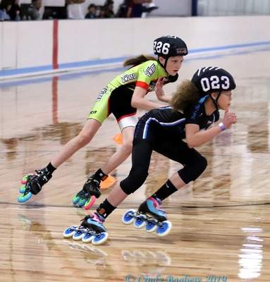 Courtesy photos Alicia McBride,11,right, aBlackhawk Middle School sixth grade honor roll student, is usually the smallest skater on the track at 4-foot-10. She has broken her left arm twice during falls, but that hasn't limited her aggressiveness. She's also used to competing against higher ages.