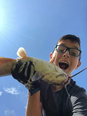Courtesy photos Connor Marcuccilli caught this 15-pound catfish in a southwest neighborhood pond.
