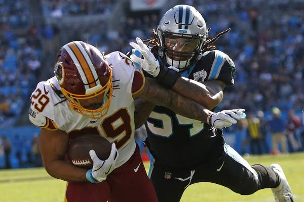 Carolina Panthers outside linebacker Shaq Thompson tackles Washington running back Derrius Guice (29) during the first half of an NFL football game in Charlotte, N.C., Sunday, Dec. 1, 2019. (AP Photo/Brian Blanco)