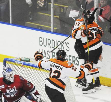 Justin A. Cohn | The Journal Gazette  Komets forward Jermaine Loewen hustles to celebrate with Matthew Boudens, right, and Brad Morrison, after Morrison scored a goal Sunday at Wings Event Center.