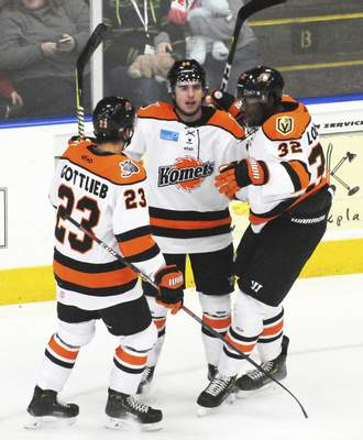 Justin A. Cohn | The Journal Gazette  Komets forward AlanLyszczarczyk, middle, celebrates with teammates Maz Gottlieb and Jermaine Loewen after scoring Sunday at Wings Event Center.