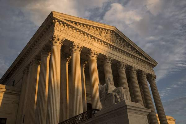 FILE - In this Oct. 10, 2017, file photo, the Supreme Court in Washington, at sunset. (AP Photo/J. Scott Applewhite, File)