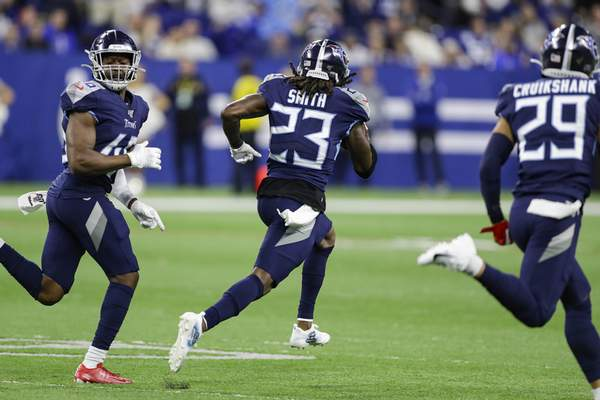 Titans cornerback Tye Smith runs back a blocked field goal for a touchdown in the fourth quarter Sunday against the Colts on Sunday. Smith's score broke a 17-all tie.