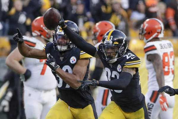 Associated Press Pittsburgh cornerback Joe Haden rejoices after intercepting a Cleveland pass during the second half Sunday in Pittsburgh.