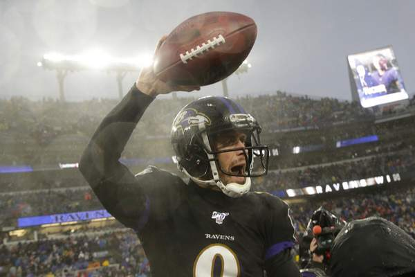 Associated Press Ravens kicker Justin Tucker celebrates after making the game-winning field goal Sunday against San Francisco in Baltimore.