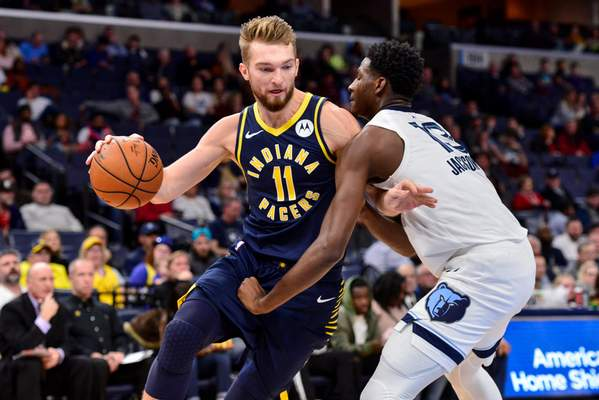 Indiana Pacers forward Domantas Sabonis (11) drives against Memphis Grizzlies forward Jaren Jackson Jr. (13) in the first half of an NBA basketball game Monday, Dec. 2, 2019, in Memphis, Tenn. (AP Photo/Brandon Dill)
