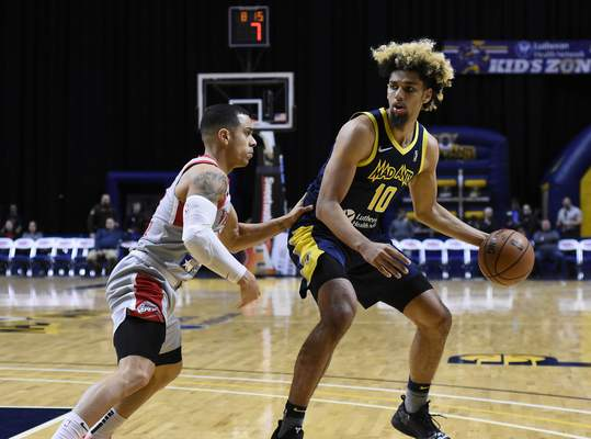 Rachel Von Stroup | The Journal Gazette  The Mad Ants' Brian Bowen II tries to get around Rio Grande Valley's Angel Rodriguez during the first quarter at the Memorial Coliseum on Monday night.