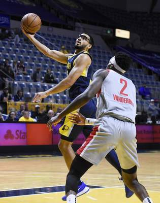 Rachel Von Stroup | The Journal Gazette  The Mad Ants' Naz Mitrou-Long shoots the ball over Rio Grande Valley's Jarred Vanderbilt during the first quarter at the Memorial Coliseum on Monday night.