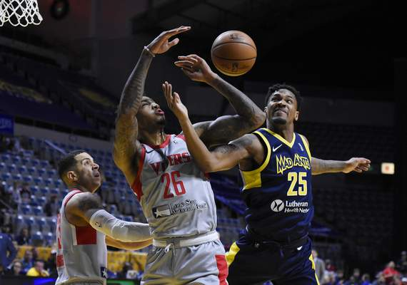 Rachel Von Stroup | The Journal Gazette  The Mad Ants' Travin Thibodeaux, right, and Rio Grande Valley's Ray Spalding fight for the ball during the first quarter at the Memorial Coliseum on Monday night.
